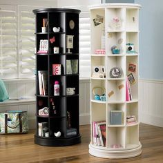 """$599.00 Revolving Bookcase: it has diameter 25,5"""" and height 69.5"""", crafted with a kiln-dried hardwood frame, swivels 360° and features 42 fixed cubbies in five different sizes, finished by hand in classic white or black paint"""