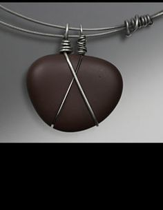 Simple wire technique. 2 wires, crossed. No tute.  .  Some really nice ideas on website