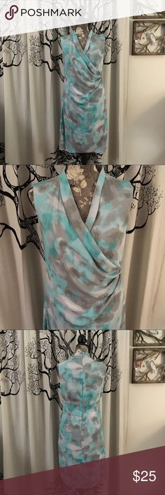 NWOT T Tahari Jersey Lined Dress This will be the most comfortable dress you own! Super soft jersey lined faux wrap dress by T Tahari in a gorgeous watercolor print with blues and greys. Silk-like exterior layer over amazingly soft rayon/spandex. Soft and stretchy, with a flattering design. Perfect unworn condition. SZ M. Would work best for an 8, 10 or 12. **Please check measurements against your own for accurate sizing.** Absolutely gorgeous summer dress! T Tahari Dresses Midi