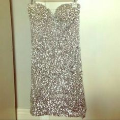 Very pretty short Sliver Sequence dress Sliver sequence dress reflects different colors in light size medium fits like a small MOVING MUST SELL MAKE OFFER Dresses Mini