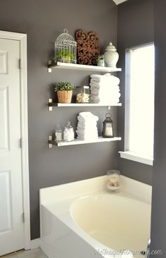Free up some counter space with IKEA EKBY shelving. Check out these ideas for creating modern, functional bathroom storage space!