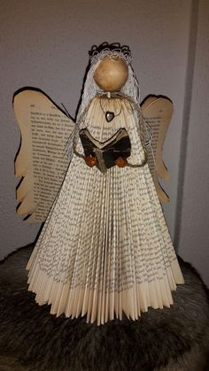 My angel made by myself Old book. Bokbretting/ bookfolding /bokvikning My angel made by myself Old book. Old Book Crafts, Book Page Crafts, Newspaper Crafts, Holiday Crafts, Book Christmas Tree, Christmas Angels, Book Tree, Folded Book Art, Paper Book