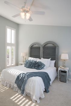 The master bedroom has been transformed with new carpeting, white wooden shutters, paint and a headboard made out of an industrial metal air vent, as seen on HGTV's Fixer Upper.