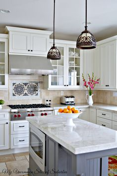Counters are Quartzite in Taj Mahal (durable yet elegant, vertical veining, polished finish), Cabinets are Kraft from Lowes painted in Dove