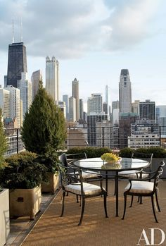 A terrace is outfitted with a Janus et Cie rug   archdigest.com
