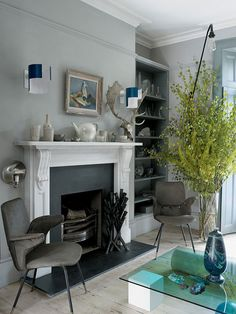 The front sitting room of Faye Toogood's London house contains a pair of Italian chairs, vintage Swedish lights above the fireplace and a vase by Hilda Hellstrom on the Element coffee table, designed by Toogood. Casa Hipster, Interior Inspiration, Room Inspiration, Home Living Room, Living Spaces, Georgian Interiors, Turbulence Deco, London House, Home Fashion