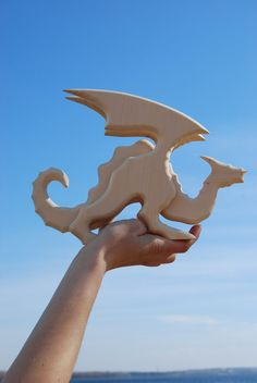 Charming wooden dragon. Wooden dragon are made of linden wood, which is soft, light, but strong enough. The wood is absolutely environment-friendly. Products surface is polished well and smooth, but has no coating. Added versions dark and red wood covering. Tinted version covered with wax and linseed oil. The toys do not have sharp corners and edges. It is light, soft, and nice on the touch.  Height 8, length 11, thickness 2.5, weight 0.77 lb