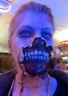 Home made Zombie costume - cheap and easy.  Liquid latex, toilet paper, fake nails, paint. And contacts.
