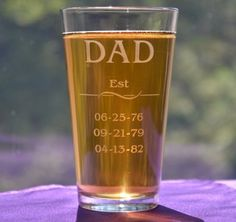 Celebrate Dad's Day with a custom drinking glass engraved with his children's birth dates. This glass mug would also be a perfect gift for Grandpa. We can engrave a different name: Daddy, Grandad, Papa. The name will be engraved in all caps like in the picture. Just write in the comments box at check out what name you would like engraved and the dates (numbers only please).
