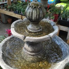 The tranquility of water flow- the beauty of a fountain... This two-tier fountain is constructed of cement and fiberglass for durability and is crafted and painted by hand.