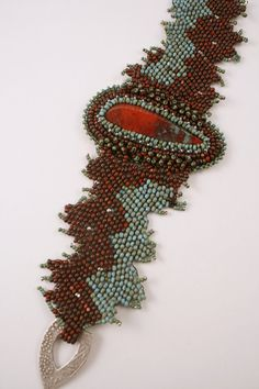 Red and Turquoise Beadweave Bracelet by jhaines on Etsy
