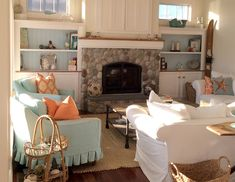Love that river (beach?) rock fireplace! a modern day beach house makeover on domino.com