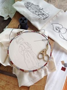 she used washi tape to dress up a plain wooden hoop. Hmmm . . . could you do this with a long strip of fabric and glue the seam along the inside of the hoop?