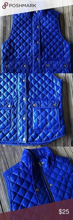 NWT J. Crew Shiny Quilted Field Puffer Vest Blue M NWT J. Crew royal blue quilted field puffer vest. Lightweight and perfect for Spring! Gold hardware. Zipper and button closure. Two large front pockets. Size M. Wear now or save for Fall. Bundle and save! J. Crew Jackets & Coats Vests