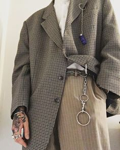 Oversized check blazer + risqué accessories + khakis