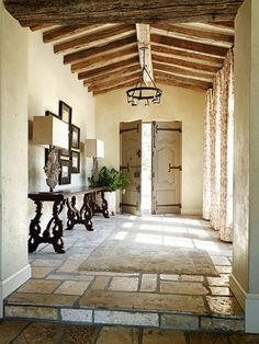 Discover inspired interior design with these photos of a rural French estate design by David Michael Miller Associates in Scottsdale, Arizona. Contact us today to learn more about starting your own home renovation or redesign project. French Country House, French Country Decorating, Rustic French, Style At Home, Entry Hallway, Entry Doors, Spanish Style, Mexican Spanish, Spanish Colonial