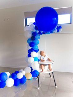 Baby Boy celebrating his Birthday with Blue Balloons #Balloonjumbo #Balloongarland #Blueballoongarland #Blueballoons #Balloons #Babyboy #Babybirthday #Boysbirthday #Birthday #Birthdayideas #Balloonideas #Bluejumboballoon #Jumboballoon #Baby #Adelaideballoon #Balloonsadelaide #Photoshoot #Bigballooon #Giantballoon #Babyphotoshoot #PuffandPop
