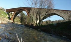 Pont Trencat (Broken Bridge) Restoration, Restoration of a Middle Ages bridge over the River Tordera, destroyed during the Napoleonic Wars Font Sites, Landscape And Urbanism, Adaptive Reuse, Over The River, Construction, Corten Steel, Napoleonic Wars, Le Moulin, Industrial Chic