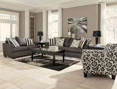 The Liberty Lounge suite includes a 3 seater, 2 seater, accent chair and scatter cushions. Mid year sale $2,999 RRP: $4,297