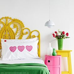 I love how this person found some totally blah wicker headboard from the 70s, spray-painted it, and now it's awesome.  Also, color!