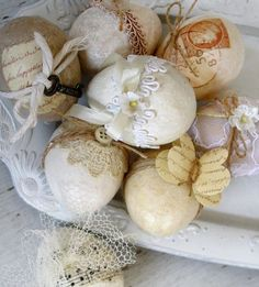 Easter eggs in creamy whites and tans, decorated with bits of lace, twine, string, paper and flowers