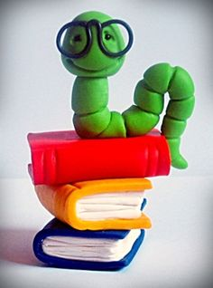 This listing is for one Bookworm Polymer Clay Sculpt.    This adorable little guy, his books were handmade by me using a blend of polymer clays and