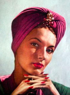 love a jeweled turban. Vintage Vogue, 1944.  See?  Like this one.  Sweeping the nation.  :)