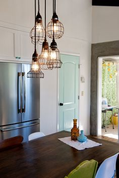 My talented sister-in-law's kitchen!  Love the lights and the blue pantry door!