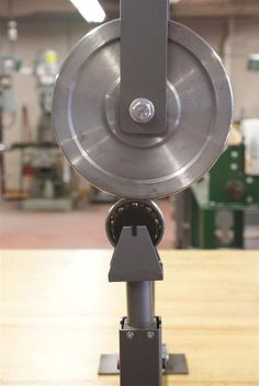 An english wheel is a classic hand-powered shop tool for making two-dimensional curves in sheet metal. Its used for making aircraft skins, car body parts,. Sheet Metal Tools, Iron Tools, Concrete Lamp, Concrete Design, Metal Fabrication Tools, Belt Grinder Plans, Car Body Parts, English Wheel, Welding Design