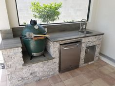 """The Big Green Egg Outdoor Kitchen - Custom Outdoor Kitchen with a Built-in """"B. - Pearl Nikolaus - The Big Green Egg Outdoor Kitchen - Custom Outdoor Kitchen with a Built-in """"B. The Big Green Egg O Big Green Egg Grill, Big Green Egg Outdoor Kitchen, Outdoor Kitchen Bars, Patio Kitchen, Outdoor Kitchen Design, Green Kitchen, Outdoor Kitchens, Outdoor Cooking, Outdoor Grill Area"""