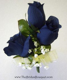 A sumptuous trio of beautiful navy blue silk roses. Whether these silk wedding corsages are destined for your wrist or pinned to the dress, they're sure to bring flattery to any member of the bridal p