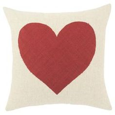 """Linen-cotton throw pillow with a heart design. Made in the USA.   Product: Pillow   Construction Material:  Linen-cotton cover and polyester fill    Color: Natural and red   Features: Zippered closure  Insert includedMade in the USA Dimensions: 17"""" x 17"""" Cleaning and Care: Spot or dry clean only"""