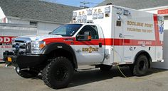 4x4 ambulance utilized for beach rescue. Some simple modifications would convert this to a great camper/BOV.
