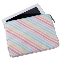 Slip your iPad into this deliciously durable iPad Case to travel with ease. With a patterned cotton lining and canvas outer, zip it shut so your iPad stays safe and clean.