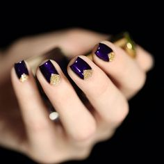 dark purple nails with golden triangles