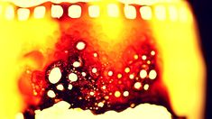 Celluloid film strip burning to a smolder.