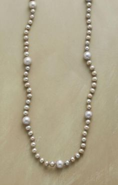This Chan Luu long pearl necklace is a striking twist on a classic style.