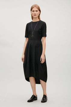 COS image 1 of Dress with cocoon skirt in Black