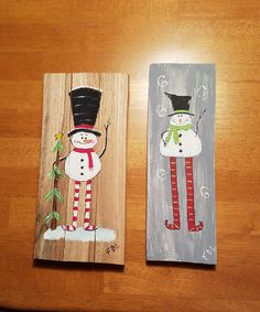 snowmen on reclaimed wood