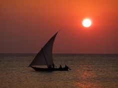Stunning red sky and calm water — so peaceful. Zanzibar Dhow.