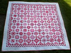 Nearly Insane quilt in Germany.Pink and red on white.