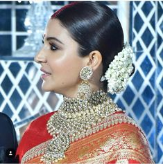 Makeup, jewellery & hair of Anushka Sharma for her wedding reception. #sabyasachi #virushka