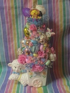 A personal favorite from my Etsy shop https://www.etsy.com/listing/498369102/easter-kitsch-lamb-and-cart-planter-with