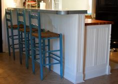 """check out the beadboard with added pieces of trim to make it look more finished. You could do this around the back of the cabinet....  Click the picture to see the """"how-to"""" on the blog."""