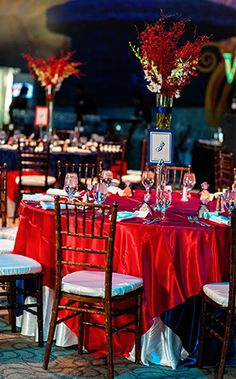Beautiful red tablescapes at Disney Animation Building wedding reception