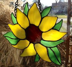 This glass is a must see in person! Stained glass sunflower measuring 8 inch wide x 9 tall . Hand crafted from yellow, green and brown glass with black stain on solder. We love custom orders. We are always available to help. Just send me a message Stained Glass Suncatchers, Stained Glass Designs, Stained Glass Projects, Fused Glass Art, Mosaic Glass, Stained Glass Patterns Free, Mosaic Projects, Craft Projects, Stained Glass Flowers