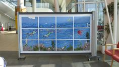 KwickScreen USA- Retractable & Mobile privacy screens with any artwork of your choosing.