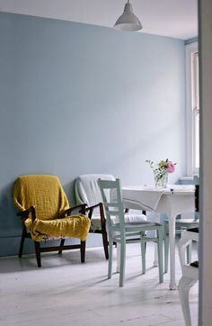 The blue room — blue walls in Parma Gray by Farrow & Ball. Blue and mustard-coloured linen throws by Volga Linen on a pair of junk armchairs from a local charity shop.