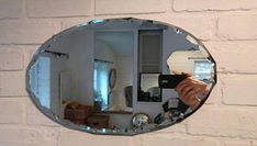 Gorgeous vintage art deco 1930's oval wall mirror with scalloped bevelled edges
