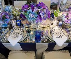 Orchids and hydrangeas overflowed out of silver vases interspersed with tea candles.